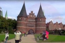 Official pink Lubeck Holstein tourism marketing Trimobil rikshaw trike