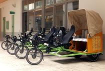 Trimobil Pedelec-Flotte der Städteregion Aachen mit Tandem-Trikes und Strandkorb-Taxis